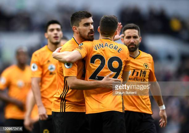Ruben Neves and Ruben Vinagre of Wolverhampton Wanderers celebrate after Matt Doherty of Wolverhampton Wanderers scores his team's first goal during...
