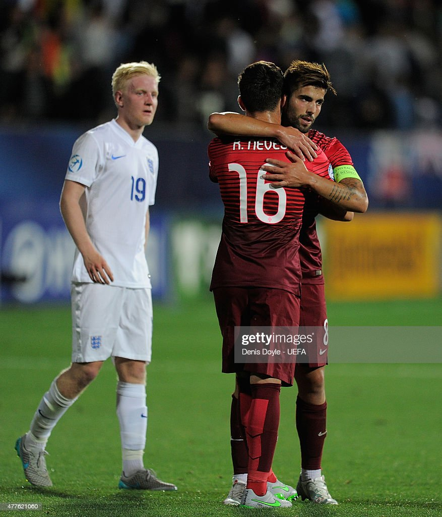 Ruben Neves and Sergio Oliveira of Portugal celebrate beside Will Hughes of England after Portugal beat England 1-0 during the UEFA Under21 European Championship 2015 match between England and Portugal at Mestsky Fotbalovy Stadium on June 18, 2015 in Uherske Hradiste, Czech Republic.