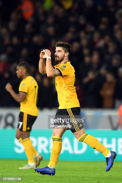 Ruben Neves celebrates scoring his side's second goal during the Emirates FA Cup Third Round match between Wolverhampton Wanderers and Liverpool at...