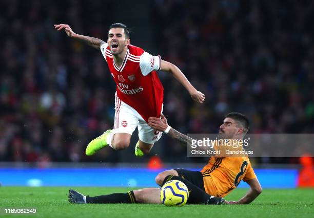 Ruben Neves of Wolverhampton Wanderers and Dani Ceballos of Arsenalin action during the Premier League match between Arsenal FC and Wolverhampton...