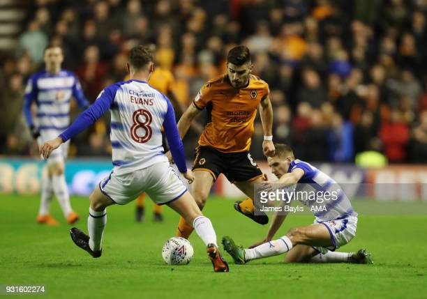 Ruben Neves of Wolverhampton Wanderers and David Edwards and George Evans of Reading during the Sky Bet Championship match between Wolverhampton...