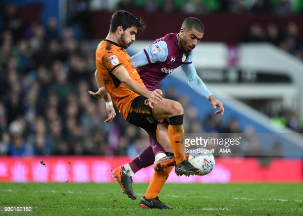 Ruben Neves of Wolverhampton Wanderers and Lewis Grabban of Aston Villa during the Sky Bet Championship match between Aston Villa and Wolverhampton...