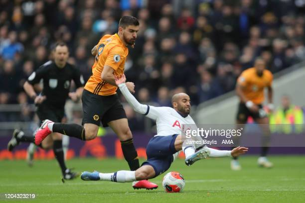 Ruben Neves of Wolverhampton Wanderers and Lucas Moura of Tottenham Hotspur during the Premier League match between Tottenham Hotspur and...
