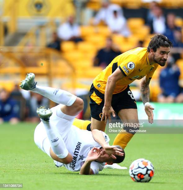 Ruben Neves of Wolverhampton Wanderers and Pontus Jansson of Brentford collide during the Premier League match between Wolverhampton Wanderers and...