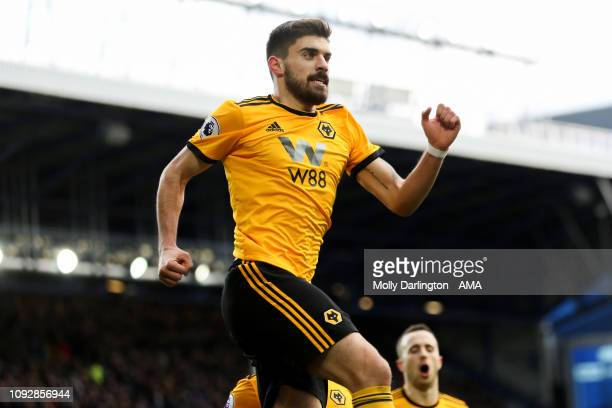 Ruben Neves of Wolverhampton Wanderers celebrates after scoring a goal to make it 01 during the Premier League match between Everton FC and...