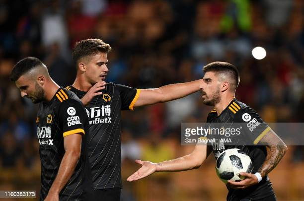 Ruben Neves of Wolverhampton Wanderers celebrates after scoring a goal to make it 0-4 from a penalty kick with Leander Dendoncker of Wolverhampton...
