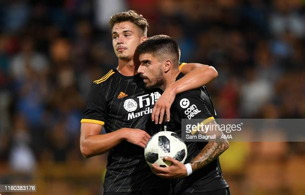 Ruben Neves of Wolverhampton Wanderers celebrates after scoring a goal to make it 04 from a penalty kick with Leander Dendoncker of Wolverhampton...