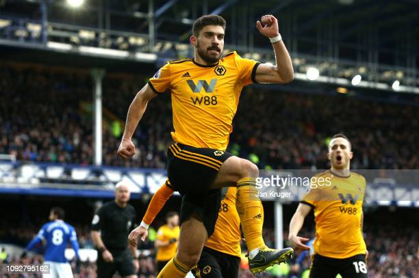 Ruben Neves of Wolverhampton Wanderers celebrates after scoring his team's first goal during the Premier League match between Everton FC and...