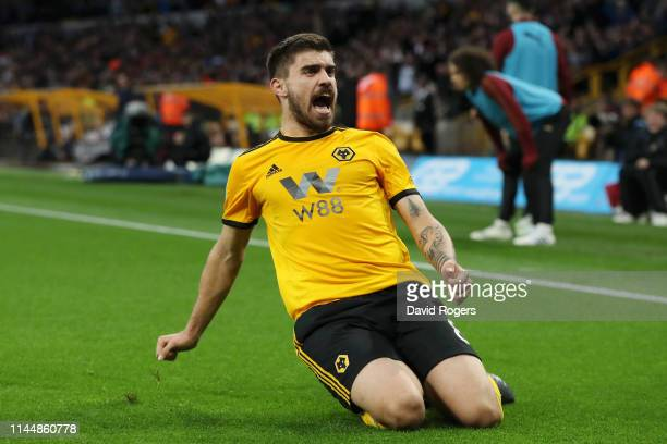 Ruben Neves of Wolverhampton Wanderers celebrates after scoring his team's first goal during the Premier League match between Wolverhampton Wanderers...