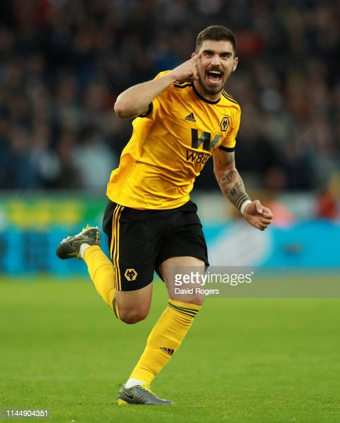 Ruben Neves of Wolverhampton Wanderers celebrates after scoring the first goal during the Premier League match between Wolverhampton Wanderers and...