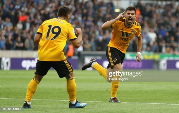 Ruben Neves of Wolverhampton Wanderers celebrates after scoring their first goal during the Premier League match between Wolverhampton Wanderers and...