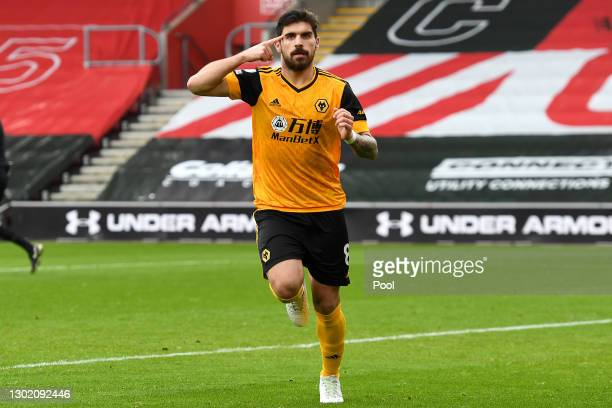 Ruben Neves of Wolverhampton Wanderers celebrates after scoring their team's first goal during the Premier League match between Southampton and...