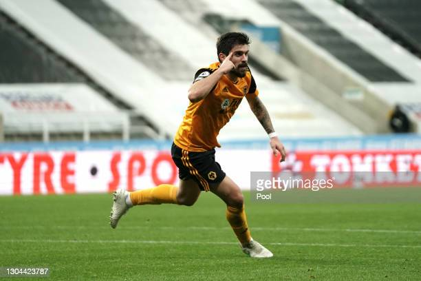 Ruben Neves of Wolverhampton Wanderers celebrates after scoring their side's first goal during the Premier League match between Newcastle United and...