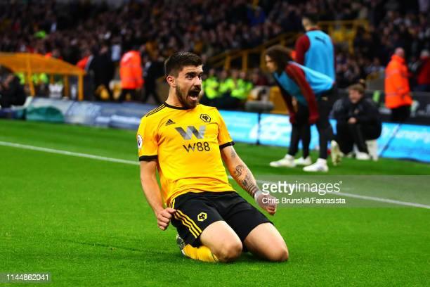 Ruben Neves of Wolverhampton Wanderers celebrates scoring the opening goal during the Premier League match between Wolverhampton Wanderers and...
