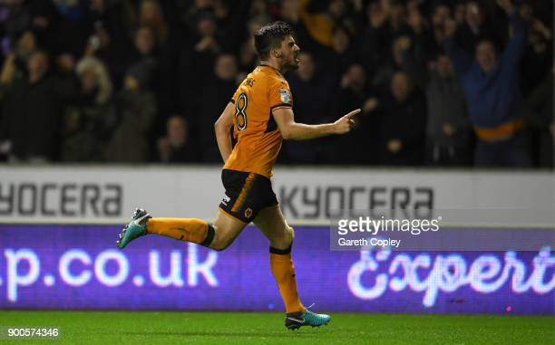 Ruben Neves of Wolverhampton Wanderers celebrates scoring the opening goal during the Sky Bet Championship match between Wolverhampton and Brentford...