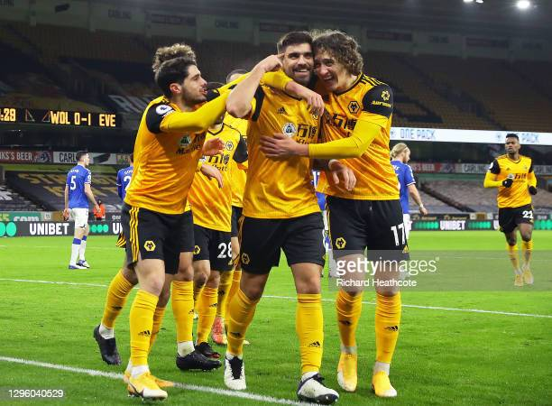Ruben Neves of Wolverhampton Wanderers celebrates with team mate Fabio Silva after scoring their team's first goal during the Premier League match...