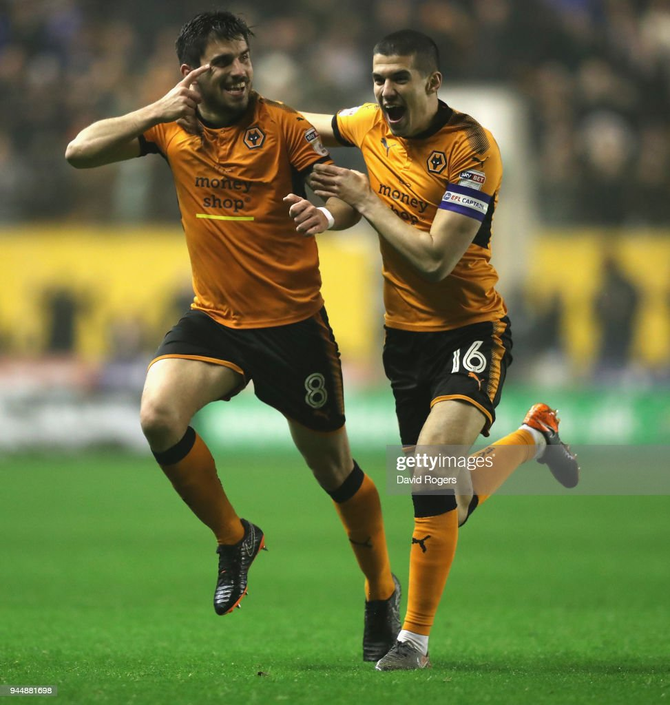 Ruben Neves (L) of Wolverhampton Wanderers celebrates with team mate Conor Coady after scoring a brilliant second half goal during the Sky Bet Championship match between Wolverhampton Wanderers and Derby County at Molineux on April 11, 2018 in Wolverhampton, England.