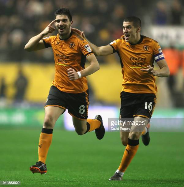 Ruben Neves of Wolverhampton Wanderers celebrates with team mate Conor Coady after scoring a brilliant second half goal during the Sky Bet...