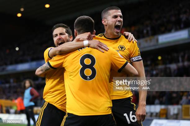 Ruben Neves of Wolverhampton Wanderers celebrates with team mates Conor Coady of Wolverhampton Wanderers and Joao Moutinho of Wolverhampton Wanderers...