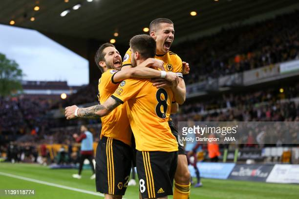 Ruben Neves of Wolverhampton Wanderers celebrates with team mates Conor Coady of Wolverhampton Wanderers and Joao Moutinho of Wolverhampton Wanderers...