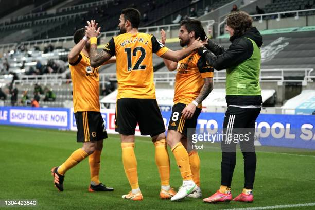 Ruben Neves of Wolverhampton Wanderers celebrates with team mates Joao Moutinho, Willian Jose and Fabio Silva after scoring their side's first goal...