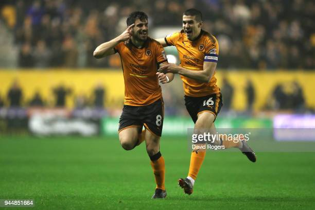Ruben Neves of Wolverhampton Wanderers celebrates with teammate Conor Coady after scoring his sides second goal during the Sky Bet Championship match...