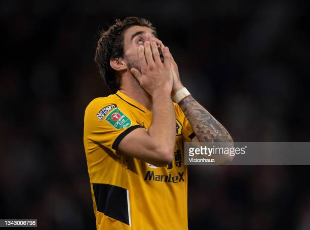 Ruben Neves of Wolverhampton Wanderers holds his head in his hands after missing his penalty during the shoot out of the Carabao Cup Third Round...