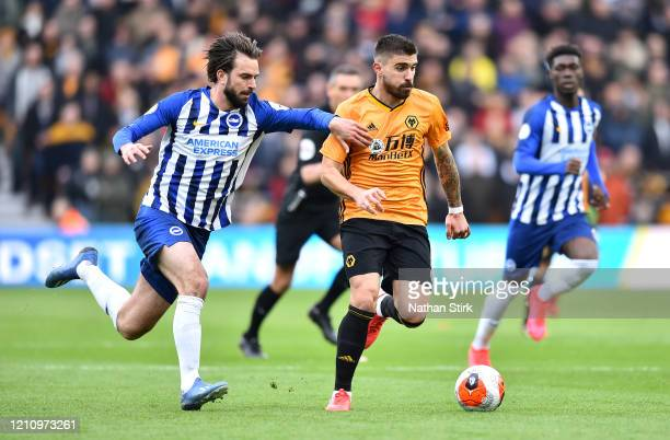 Ruben Neves of Wolverhampton Wanderers is challenged by Davy Propper of Brighton and Hove Albion during the Premier League match between...