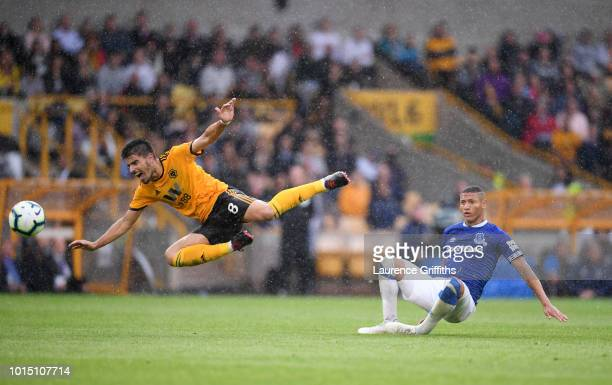 Ruben Neves of Wolverhampton Wanderers is fouled by Richarlison of Everton during the Premier League match between Wolverhampton Wanderers and...