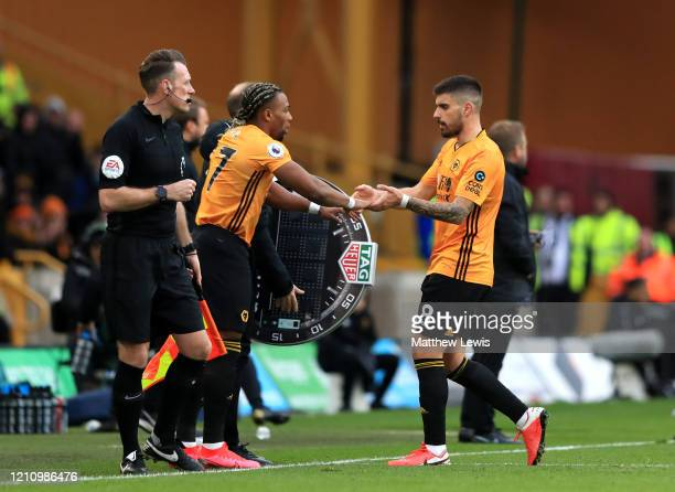 Ruben Neves of Wolverhampton Wanderers is substituted for team mate Adama Traore during the Premier League match between Wolverhampton Wanderers and...