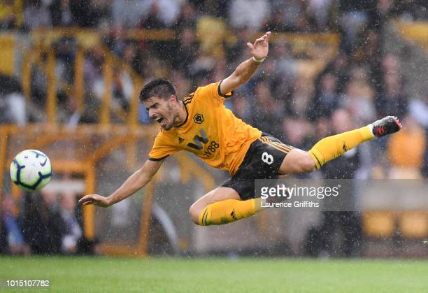 Ruben Neves of Wolverhampton Wanderers reacts after being fouled by Richarlison of Everton during the Premier League match between Wolverhampton...