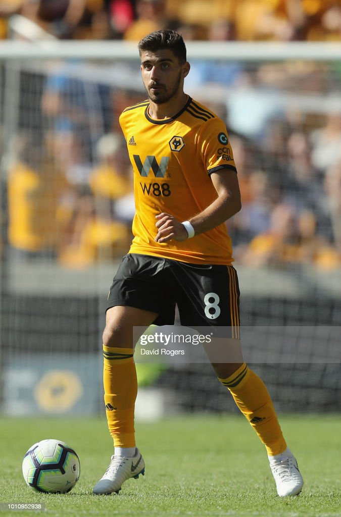 Ruben Neves of Wolverhampton Wanderers runs with the ball during the pre-season friendly match between Wolverhampton Wanderers and Villareal at Molineux on August 4, 2018 in Wolverhampton, England.