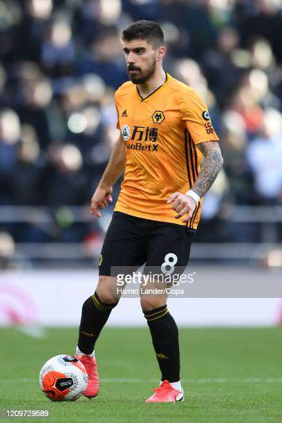 Ruben Neves of Wolverhampton Wanderers runs with the ball during the Premier League match between Tottenham Hotspur and Wolverhampton Wanderers at...