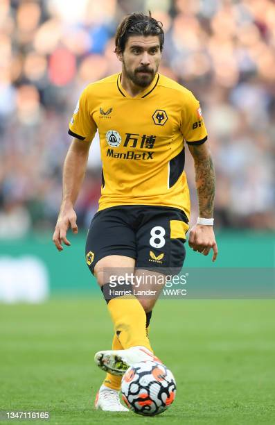 Ruben Neves of Wolverhampton Wanderers runs with the ball during the Premier League match between Aston Villa and Wolverhampton Wanderers at Villa...