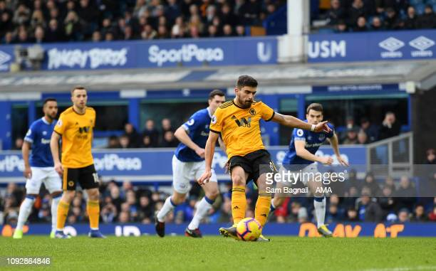 Ruben Neves of Wolverhampton Wanderers scores a goal to make it 0-1 from a penalty kick during the Premier League match between Everton FC and...