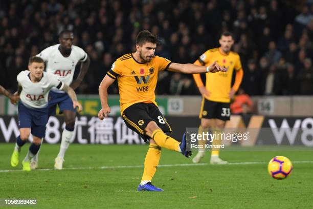 Ruben Neves of Wolverhampton Wanderers scores his team's first goal from the penalty spot during the Premier League match between Wolverhampton...
