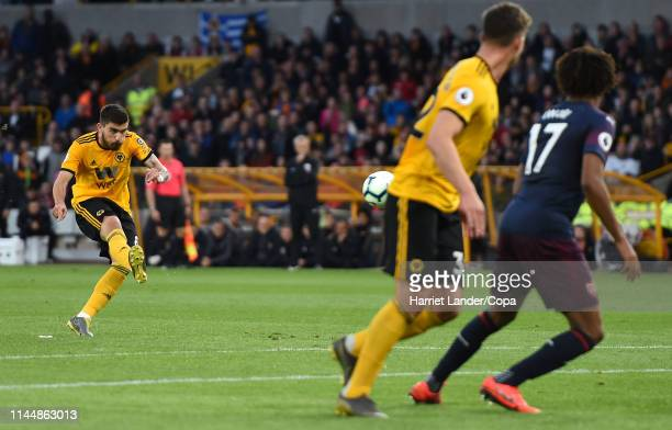 Ruben Neves of Wolverhampton Wanderers scores his team's first goal during the Premier League match between Wolverhampton Wanderers and Arsenal FC at...