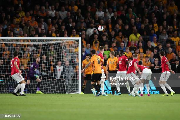 Ruben Neves of Wolverhampton Wanderers scores the equaling goal during the Premier League match between Wolverhampton Wanderers and Manchester United...