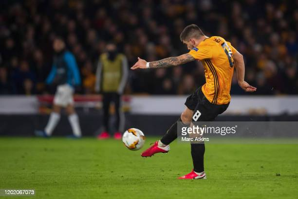 Ruben Neves of Wolverhampton Wanderers scores their 2nd goal from long range during the UEFA Europa League round of 32 first leg match between...