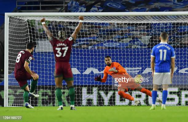 Ruben Neves of Wolverhampton Wanderers scores their team's third goal from the penalty spot during the Premier League match between Brighton & Hove...