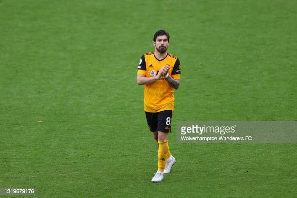 Ruben Neves of Wolverhampton Wanderers shows his appreciation to the fans during the lap of honor after the Premier League match between...