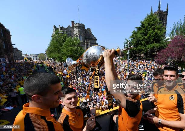 Ruben Neves of Wolverhampton Wanderers with the trophy during their celebrations of winning the Sky Bet Championship on a winners parade around the...