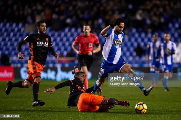 Ruben Nunes 'Vezo' of Valencia CF competes for the ball with Florin Andone of Deportivo de La Coruna during the La Liga match between Deportivo La...