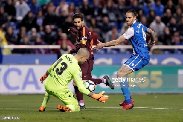 Ruben of Deportivo La Coruna Lionel Messi of FC Barcelona Raul Albentosa of Deportivo La Coruna during the La Liga Santander match between Deportivo...