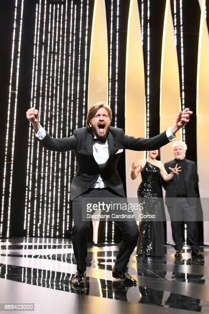 Ruben Ostlund celebrates on stage after receiving the Palme d'Or for the movie The Square during the Closing Ceremony during the 70th annual Cannes...