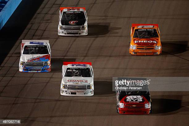 Ruben Pardo driver of the BYB Chevrolet leads a pack of trucks during the NASCAR Camping World Truck Series Lucas Oil 150 at Phoenix International...