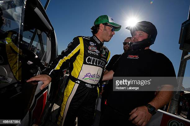 Ruben Pardo driver of the BYB Chevrolet stands on the grid during qualifying for the NASCAR Camping World Truck Series Lucas Oil 150 at Phoenix...