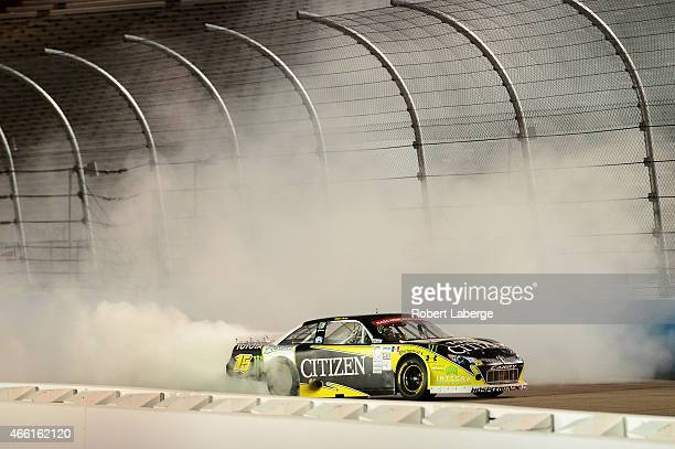 Ruben Pardo driver of the CitizenPotosinos Toyota celebrates with a burnout after winning the NASCAR Mexico Series Toyota 120 at Phoenix...
