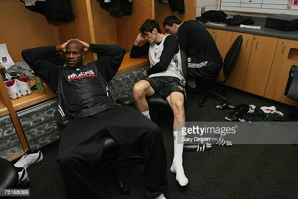 Ruben Patterson and Ersan Ilyasova of the Milwaukee Bucks wait for game time in the locker room prior to the game against the Phoenix Suns on January...