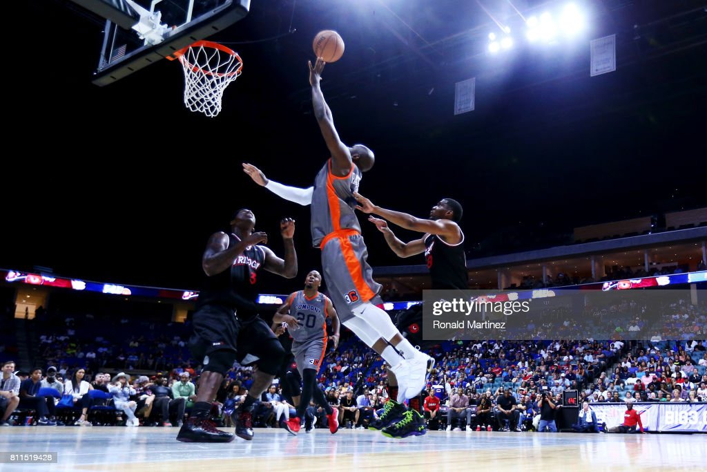 Ruben Patterson #21 of 3s Company attempts a shot while being guarded by Al Harrington #3 and James White #8 of Trilogy during week three of the BIG3 three on three basketball league at BOK Center on July 9, 2017 in Tulsa, Oklahoma.